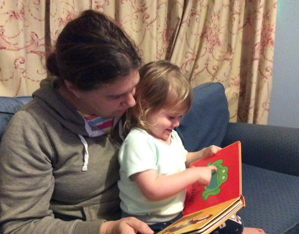 Louise enjoying a book with her little one